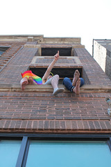 Over There (Flint Foto Factory) Tags: chicago illinois urban city summer june 2018 north wrigleyville boystown lakeview halsted melrose belmont 3232 annual lgbt lbgtq pride parade lesbian gay bisexual trans queer celebration life float crowd balcony point pointing rainbow flag brick building condominium condo apartment