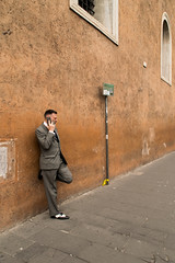 all roads lead to Rome 22/33 (Giorgos Voulgaris) Tags: nikon d5300 digital color candid rome street man orange suit standig wall