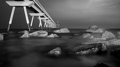 Pont del Petroli (Fnikos) Tags: sea water mar mare wave rock bridge puente pont sky skyline moon light cloud blackandwhite monochrome outdoor