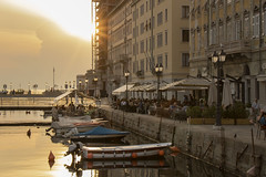 Aperitivo on the canal, Trieste (ScotchBroom) Tags: trieste fvg friuliveneziagiulia italy italia goldenhour canal canale sunset goldenlight boats aperitivo