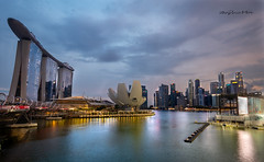 The Marina Bay Singapore (melvhsc100) Tags: marinabay singapore singaporeattractions singaporenicescenery downtown singaporefinancialcentervibrant skyline bluehour bluesky seascape cloudscape architecture reflections colorful longexposure landscape nikon7200 nikon1024mm