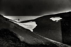 Depiction Of Light 5 (pni) Tags: monochrome reflection stg snow mountain side sky cloud through frombuswindow suðurlandsvegur road1 is18 iceland ísland pekkanikrus skrubu pni