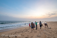 A group of people hangout on the beach looking out into the waves Monrovia, Liberia (Remsberg Photos) Tags: beach tropical travel tourists landscape scenery scenic traveler africa developing liberia monrovia westafrica ocean waves surf sand water tide dusk sandy picturesque group enjoyment sunset