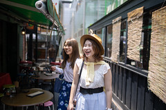 Young female friends walking in street (Apricot Cafe) Tags: img96534 asia asianandindianethnicities japan japaneseethnicity shibuyaward tokyojapan backlit buildingexterior capitalcities carefree casualclothing colorimage day enjoyment friendship happiness harajukudistrict leisureactivity lifestyles opencafe outdoors people photography realpeople restaurant shopping smiling street summer sunlight sustainablelifestyle threequarterlength toothysmile tourism tourist traveldestinations twopeople walking wall weekendactivities women youngadult shibuyaku tōkyōto jp