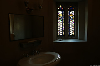 Toilet with a stained glass window