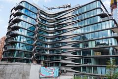 Zaha Hadid's Last Building (UrbanphotoZ) Tags: sahahadid underconstruction condominiums modern reflections streetart dancer woman betten jordanbetten nyc 2013 chelsea highline manhattan newyorkcity newyork ny