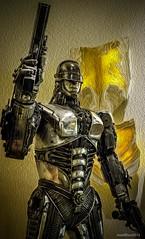 Dredd (evanffitzer) Tags: cartoon dredd judge lasvegas vegas art sculpture indoors gun metal helmet character fujix100s fujifilmx100s comics future scifi