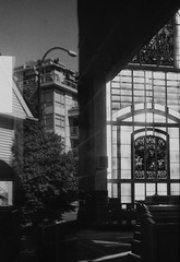 Half and Half - Film Leica (Photo Alan) Tags: reflection church windows churchwindows building blackwhite blackandwhite dark city cityscape cityofvancouver light street streetphotography leica leicaiiif leicasummarit5cmf15