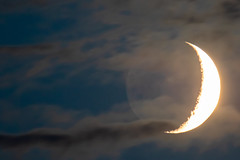 Moonset with partial cloud cover. (Owen Llewellyn) Tags: owenllewellyn cygnusimaging canon 7dmkii 7dmk2 7dii 400mm f56l london brixton lambeth nature natural south moon luna selene clouds dusk moonset twighlight contrast