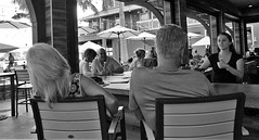 Lean approval (Twila1313) Tags: bar outdoorbar leaning bodylanguage thumbsup approval bartender man woman streetphotography streetshot candid monochrome blackandwhite sonynex5n sigma19mmf28