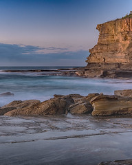 Rocky Seascape and Headland (Merrillie) Tags: daybreak landscape nature dawn terrigal waves waterscape water theskillion newsouthwales clouds earlymorning nsw sunrise sky ocean morning sea rocky coastal rocks outdoors seascape coast centralcoast cloudy australia