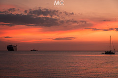 Different ways (Mariano Colombotto) Tags: santamarta colombia sea mar dusk sunset atardecer ocaso travel water colours tones sky cielo ngc vessel sailboats clouds nikon photographer photography