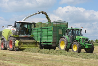 Claas Jaguar 970 SPFH filling a Broughan Engineering Mega HiSpeed Trailer drawn by a John Deere 6930 Tractor