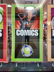 Comics (Trippin' all over the place) Tags: comics reading mall shopping window display sign words kids stcharles missouri smartphone topazlabs nik pse12 colorful