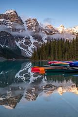 Canoes at Moraine Lake (Bronte Boy) Tags: moraine lake reflection canoe mountains sunrise fujixt2