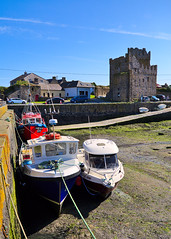 Castle and fishing boats (Jacek Rudowski) Tags: slade wexford ireland county country countryside boats fishing fishingboats sunshine castle old history historic historical walls fort fortress tower buildings architecture cars people blue sky weekend sunny day travel travelphoto travelphotography tourism light shadow shadows shade lightandshadow lightandshadows sunlight sunnyday landscape seaside coast colorphoto colourphoto colorphotography colourphotography colors colours colourful