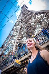 Stephanie standing just below the iconic Eiffel tower.