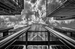 One Canada Square (Leipzig_trifft_Wien) Tags: london england vereinigteskönigreich gb architecture perspective pov reflection sky lookingup black white building skyscarper modern contemporary glass facade bnw blackandwhite contrast city urban tall cladding high tower