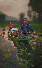 The Morning Light.color (tchakladerphotography) Tags: lake dal kashmir boat light people person atmosphere mood tradition colorful