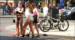 `2342 (roll the dice) Tags: london streetphotography pretty sexy girls mad sad fun funny happy smile reaction urban unaware unknown people fashion hoop uk classic art portrait stranger candid shops shopping natural sunny hot weather canon tourism tourists camden kingscross hotpants bum glitter traffic bicycle surreal hair sunglasses travel drinking eat flares sixties facepaint chopper