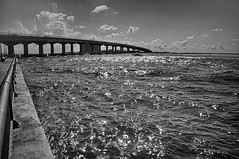 Bridge at Perdido Pass (Howell Weathers) Tags: alabama orangebeach hdr sea ocean sky clouds nature outdoor perdidopass blackandwhite monochrome blackwhite bridge alabamapoint
