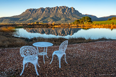 Seat with a view (NettyA) Tags: australia eaglesnestretreat mountain mtroland tasmania tassie westkentish dam landscape reflection sunrise water chairs table