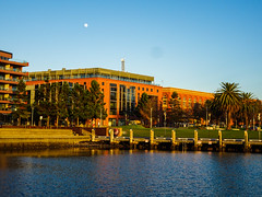 Moon over Deakin Uni (dmoyle37) Tags: goldenhour geelong moon water university buildings architecture