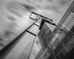 Headframe Lines (frank_w_aus_l) Tags: zollverein monochrome sw bw longexposure noiretblanc netb nikon d800 nikkor pce 2435 fineart essen industry unesco headframe reflection sky stream city architecture tilt shift manual