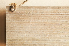 Part of Wooden Plank On Ropes (dejankrsmanovic) Tags: plate plank souvenir note title copyspace wall indoor texture wood wooden brown abstract material natural simple sparse structure detail closeup small partof tree timber textured bumped object stilllife