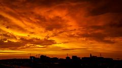 Aftermath of a powerful thunderstorm over Alexandria, VA -- THROWBACK THURSDAY 6.21.18 (John Brighenti) Tags: clouds sky orange sunset red alexandria va virginia stormclouds storm storms thunderstorm samsung galaxy s6
