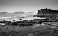 Black and White Early Morning Seascape with Headland (Merrillie) Tags: daybreak theskillion australia blackandwhite nature water terrigal nsw rocky sea clouds newsouthwales rocks earlymorning morning landscape centralcoast ocean monochrome sunrise waterscape coastal outdoors sky seascape dawn coast cloudy waves