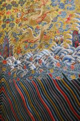 Wonderfully embroidered Chinese robe with a dragon and waves (Monceau) Tags: embroidered chinese robe dragon waves colorful muséeguimet paris lemondevudasieaufilsdescartes