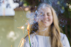 Happy Fourth of July! (aaronrhawkins) Tags: fourth july fourthofjuly independence day sparkler firework spark fire smoke light girl teenager teen smile happy celebration provo utah aaronhawkins hot burn celebrate