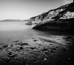 Light on the rocks (NikNak Allen) Tags: bovisand devon plymouth beach bay coast sand stone stones cliff grey black white seascape view look early morning low shore shoreline square blackandwhite longexposure shadows smooth