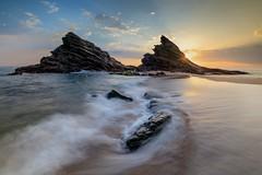 Sunset at Porto Covo, Portugal (Justin Minns) Tags: blur portocovo beach sunset rush shapes water stacks rocks swoosh atlantic coast motion portugal
