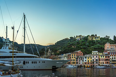 Portofino By The Boat Load (Tim Bellette) Tags: architecture blue building color colour dock europe green house italy landscape mountain river sailboat sea sky street tourist travel water yellow boat day eu expensive harbour italian ocean portofino rich ship trees
