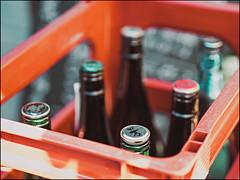 Sake Bottles (David Panevin) Tags: fukushima fukushimaku 福島区 大阪 osaka kansai japan olympus omd em1 mzuikodigitaled45mmf18 street path kirin sake bottles crates colors urbanfragments bokeh bokehlicious davidpanevin