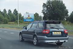 1997 Suzuki Baleno Wagon (NielsdeWit) Tags: nielsdewit slnj78 suzuki baleno wagon estate stationwagon a12 driving highway twotone
