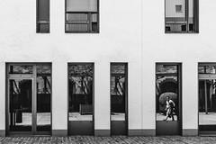man in the mirror (Zesk MF) Tags: bw black white mono schwar weiss spiegelung reflection window fenster street candid people walking strase zesk building urban