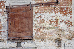 Out of Service (Roger Daigle) Tags: abandoned door cotton mill nikon rust