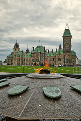 Centennial Flame and East Block (steveboer.com) Tags: centennialflame parliament canada eastblock government building castle city tower architecture landmark sky old town spire outdoors urban outdoor grass travel cloud touristattraction front house water tourism green large facade monument park
