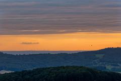 windy motion (Rita Eberle-Wessner) Tags: windturbines windräder windkraftanlagen heisluftballon odenwald vöckelsbach pfalz rheinebene hügel hills mittelgebirge wald forest landschaft landscape himmel sky clouds wolken sonnenuntergang sunset orange wiesen meadows wka windenergy