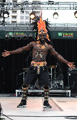 Male Masquerader (Poocher7) Tags: people portrait male malemasquerader tdbank iriemusicfestival2018 dancer stage lights drums feathers orangefeathers music socamusic smile caribbean bacchanal mississauga ontario canada sundaylights d850 nikon caribbeanmusic piercednipple blackshoes blackshorts decorations headband piercednosestud
