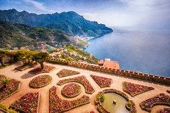 Villa Rufolo View - Textured (byron bauer) Tags: byronbauer villa rufolo ravello italy amalfi coast ocean sea water mediterranean tyrrhenian seascape landscape view vista blue sky clouds mountains hills shore cliff garden pattern flowers path texture painterly formal classic salerno terraces gothic
