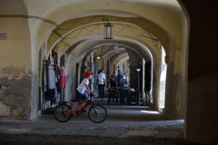 DSC_6800_4637. Animation under the ancient arcades - Animazione sotto gli antichi portici - (angelo appoloni) Tags: liguria noli portici animazione negozio di abbigliamento piccolo ristorante ragazzo bicicletta luci ed ombre ligurian coast animation clothing shop small restaurant boy bicycles lights shadows arcades t
