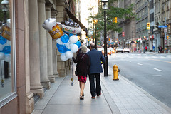 Happy Retirement (cookedphotos) Tags: 2018inpictures toronto ontario canada ca canon 5dmarkiv streetphotography couple love retirement balloons celebrate sidewalk 365project p3652018