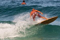 Surfing at Nai Harn beach, Phuket, Thailand (Phuketian.S) Tags: surf surfing wave phuket nai harn girl man beach sea island bikini sport travel holiday water andaman board people phuketian cliff rock landscape ocean mountain