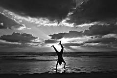 Having fun (Roi.C) Tags: sun sunlight sunset sunrays sunbeams clouds cloud sky water sea wave waves sand beach season seascape landscape reflection silhouette people nikkor nikond5300 nikon mediterraneansea blackwhite blackandwhite black white monochrome israel telaviv outdoor candid cloudscape