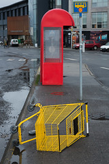 Some Basic Colours (pni) Tags: street reykjavik bussstop shoppingcart red yellow sign booth cover shelter trolley wall car building is18 iceland ísland pekkanikrus skrubu pni