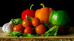 Still life vegetables (Andy Sut) Tags: vegetables stilllife studio peppers tomatoes garlic rocketleaves andysutton food edible eating dining lumix bridgecamera amateur homestudio studiolighting still